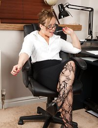 Mature secretary shows her..